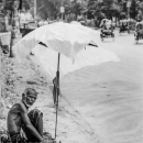 Man And Umbrella By The Roadside