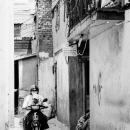 Mother And Her Little Son On The Motorbike