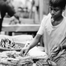 Young Man Selling Sweets