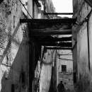 Figure Walking The Narrow Alley