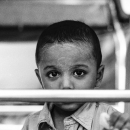 Boy Looking Through The Handrail