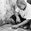 Young Man Playing The Board Game