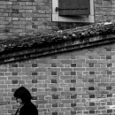 Woman And Door On The Brick Wall