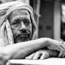 Laborer Wrapping A Cloth Around His Head