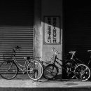 Bicycles In Front Of The Closed Shutter