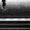 Climbing Figure On Stairway