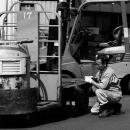 Man Repairing A Turret Truck