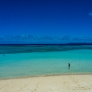 Figure Standing In The Blue Ocean In Hateruma