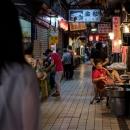 Woman Sitting In Dongsanshui Street Market