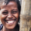 Boy Smiled Beside A Bamboo Pillar @ India