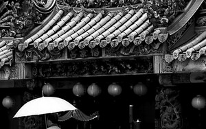 Umbrella And The Entrance Of A Temple