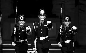 Three Guardsmen Raising Arms