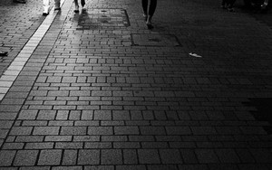 Pedestrians In The Dark Street