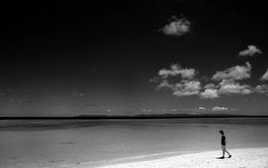 Woman And Clouds On Nichihama Beach