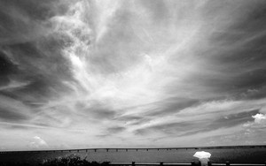 Umbrella And The Silhouette Of The Bridge Under The Sky