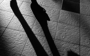 Shadow Of A Woman's Legs