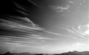 Silhouettes Of Mountains On The Ground And Clouds In The Sky
