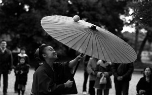 Ball On Her Umbrella