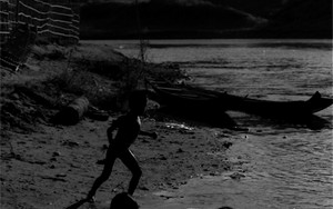 Silhouettes Of Three Kids Playing On The Dry Riverbed