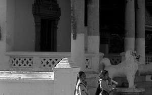 Girls Walking In Front Of A Buddhist Temple