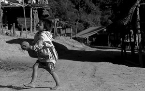 Shoeless Boy Playing With A Ball