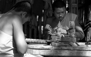 Carving Monks And Incomplete Buddha Images
