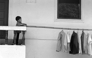 Little Boy And Laundry Pole On The Veranda