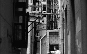 Man With A Bucket In The Alleyway