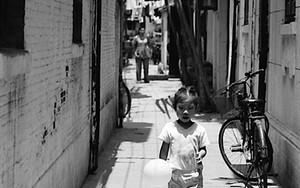 Girl Walks Sulkily With A Balloon
