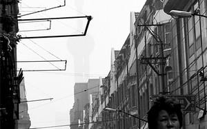 Woman Sprinting Between Buildings