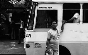 Man Beside A Bus