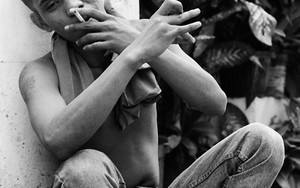 Young Man Smokes And Strokes A Pose
