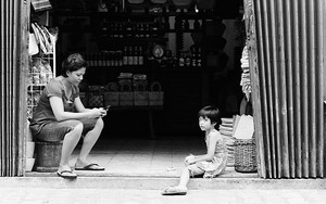 Woman And Girl In Front Of A Shop