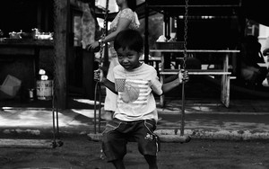 Boy Straining On The Swing