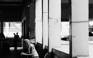 Older Woman In A Corner Of The Market
