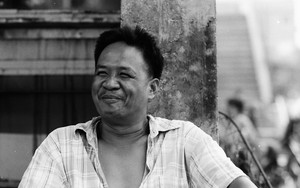Smiling Man In The Market