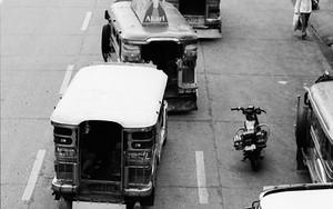 Policeman Beside Jeepney