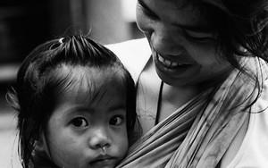Girl Nestling On Mother