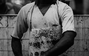 Butcher Wearing A Dirty Apron