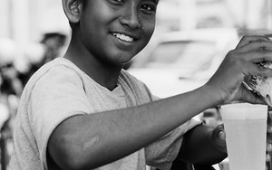 Smiling Boy At A Juice Stand