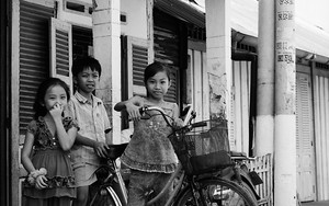 Three Kids And One Bicycle