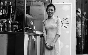 Woman Wearing Ao Dai At A Stall