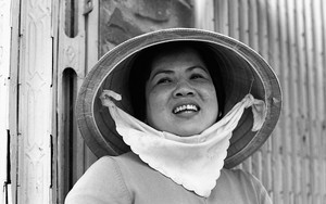 Woman Wearing A Conical Hat In The Market
