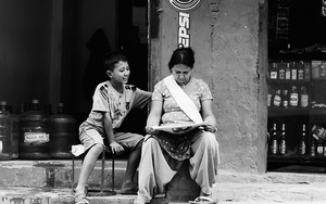 Mother, Her Son And Newspaper