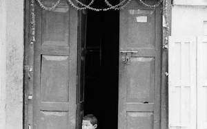 Boy At The Entrance Of A Restaurant
