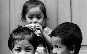 Three Kids Sitting In The Lane