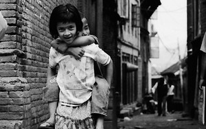 Girl Carries Her Brother