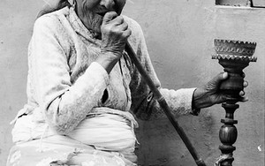 Old Lady Smoking A Hookah