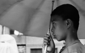 Boy With The Umbrella