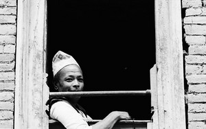 Man With A Dhaka Topi Sitting By The Window